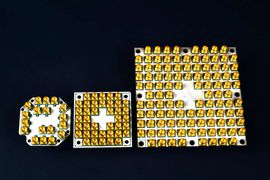 Intel Corporation is making fast progress scaling superconducting quantum computing test chips to higher qubit counts -- from 7, to 17 and now 49 qubits (left to right). Multiple gold connectors are required to control and operate each qubit. (Credit: Walden Kirsch/Intel Corporation