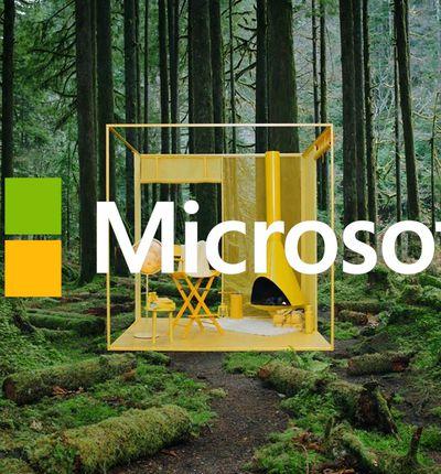 Des meubles jaunes posés au coeur d'une forêt avec le logo Microsoft en surimpression.