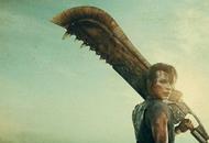 Milla Jovovich avec son arme pour le film Monster Hunter